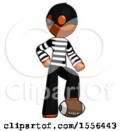 Poster, Art Print Of Orange Thief Man Standing With Foot On Football