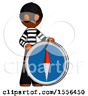 Orange Thief Man Standing Beside Large Compass