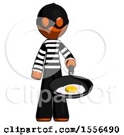 Orange Thief Man Frying Egg In Pan Or Wok