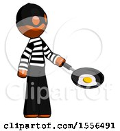 Orange Thief Man Frying Egg In Pan Or Wok Facing Right