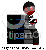 Red Thief Man Resting Against Server Rack Viewed At Angle