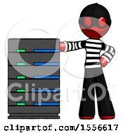 Red Thief Man With Server Rack Leaning Confidently Against It