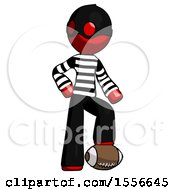 Red Thief Man Standing With Foot On Football