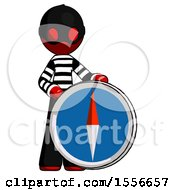 Red Thief Man Standing Beside Large Compass
