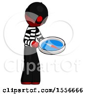 Red Thief Man Looking At Large Compass Facing Right