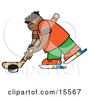 Sporty Boy Hitting A Hockey Puck During A Game Or Practice Clipart Illustration