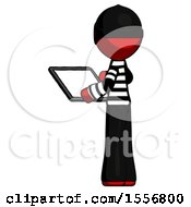 Red Thief Man Looking At Tablet Device Computer With Back To Viewer