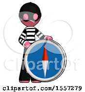 Pink Thief Man Standing Beside Large Compass