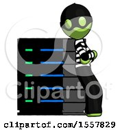 Green Thief Man Resting Against Server Rack Viewed At Angle