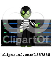 Green Thief Man With Server Racks In Front Of Two Networked Systems