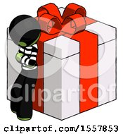 Green Thief Man Leaning On Gift With Red Bow Angle View