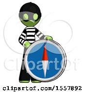 Green Thief Man Standing Beside Large Compass
