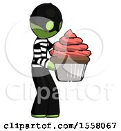Green Thief Man Holding Large Cupcake Ready To Eat Or Serve