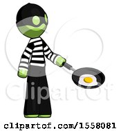 Poster, Art Print Of Green Thief Man Frying Egg In Pan Or Wok Facing Right