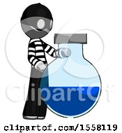 Gray Thief Man Standing Beside Large Round Flask Or Beaker