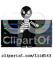 Gray Thief Man With Server Racks In Front Of Two Networked Systems