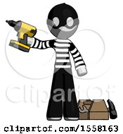 Gray Thief Man Holding Drill Ready To Work Toolchest And Tools To Right