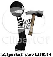 Gray Thief Man Hammering Something On The Right