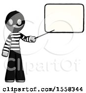 Gray Thief Man Giving Presentation In Front Of Dry Erase Board