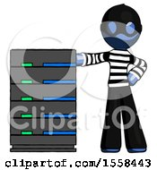 Blue Thief Man With Server Rack Leaning Confidently Against It