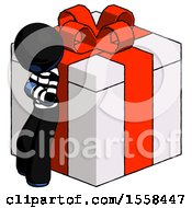 Blue Thief Man Leaning On Gift With Red Bow Angle View