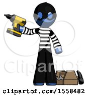 Blue Thief Man Holding Drill Ready To Work Toolchest And Tools To Right