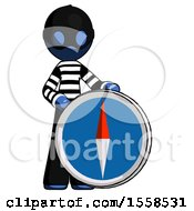 Blue Thief Man Standing Beside Large Compass