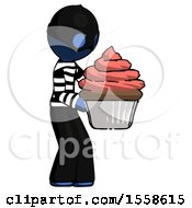 Blue Thief Man Holding Large Cupcake Ready To Eat Or Serve