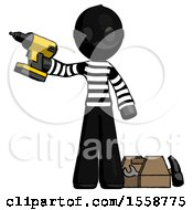 Black Thief Man Holding Drill Ready To Work Toolchest And Tools To Right