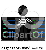 Black Thief Man With Server Racks In Front Of Two Networked Systems