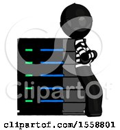 Black Thief Man Resting Against Server Rack Viewed At Angle