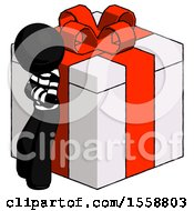 Black Thief Man Leaning On Gift With Red Bow Angle View