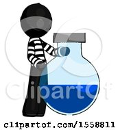 Black Thief Man Standing Beside Large Round Flask Or Beaker