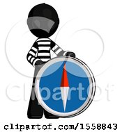 Black Thief Man Standing Beside Large Compass