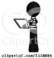 Black Thief Man Looking At Tablet Device Computer With Back To Viewer