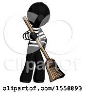 Black Thief Man Sweeping Area With Broom