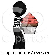 Black Thief Man Holding Large Cupcake Ready To Eat Or Serve