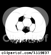Silhouetted Crowd Of Hands Under A Soccer Ball