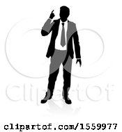 Silhouetted Business Man Pointing Up With A Reflection Or Shadow