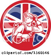 Clipart Of A Retro Male Welder Looking Back Over His Shoulder In A Union Jack Flag Circle Royalty Free Vector Illustration