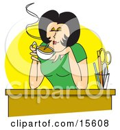 Happy Woman Enjoying The Wonderful Scent Of Her Hot Coffee While Sitting At Her Desk On A Break