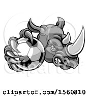 Clipart Of A Tough Rhino Monster Mascot Holding Out A Soccer Ball In One Clawed Paw Royalty Free Vector Illustration by AtStockIllustration