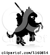 Black Silhouetted Medieval Knight On A Rearing Horse With A Shadow On A White Background
