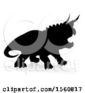 Black Silhouetted Triceratops Dinosaur With A Shadow On A White Background