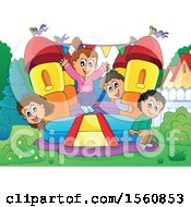 Group Of Children Playing On A Bouncy House Castle In A Yard