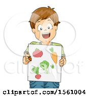 Happy White Boy Holding A Board Of Drawn Vegetables