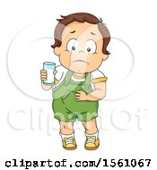 White Toddler Boy Holding A Glass Of Milk And Rubbing His Tummy