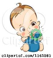 Toddler Girl Teething On An Ice Chew