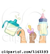 Kids Hands Holding A Pacifier And Milk In Sippy Cup And Baby Bottle