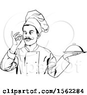 Black And White Male Chef Gesturing Perfect And Holding A Cloche